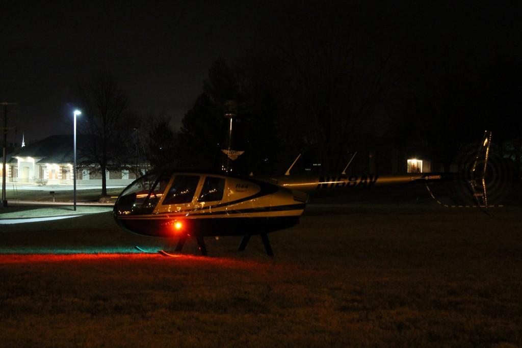 A patient arrives via helicopter